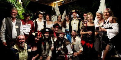 A group of pirates playing A Dead Man's Chest murder mystery game