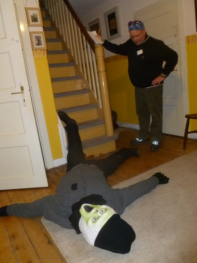 A fake body lies at the bottom of the stairs