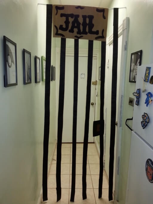 Way out West – some paper strips (could use fabric too) hung from a tension rod turns a useless hallway into a jail for the Silver Dollar saloon! 