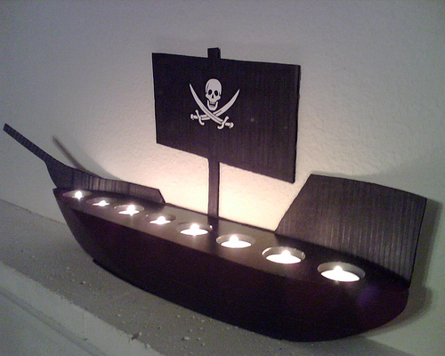 A Dead Man's Chest – candle ship. The black votive holder was found at Goodwill. The back drop is just cardboard painted black. 